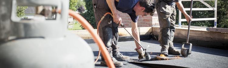 Vervangen bitumen dakbedekking